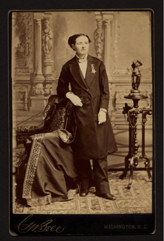 Dr. Mary Walker wearing her Congressional Medal of Honor, pants, and a dinner jacket